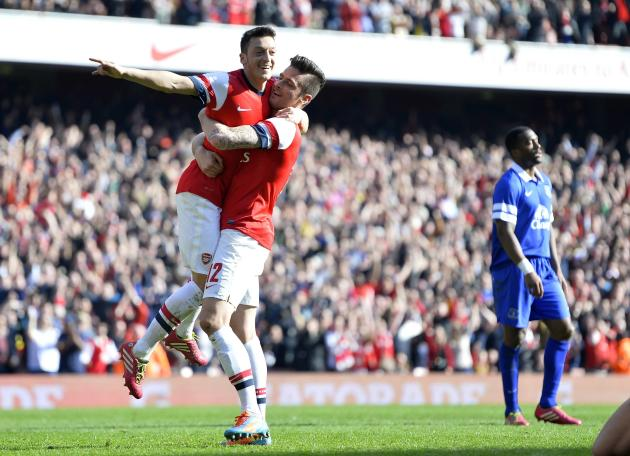 Arsenal's Giroud celebrates with team mate Ozil after scoring a second goal against Everton during their English FA Cup quarter final soccer match at the Emirates stadium in London