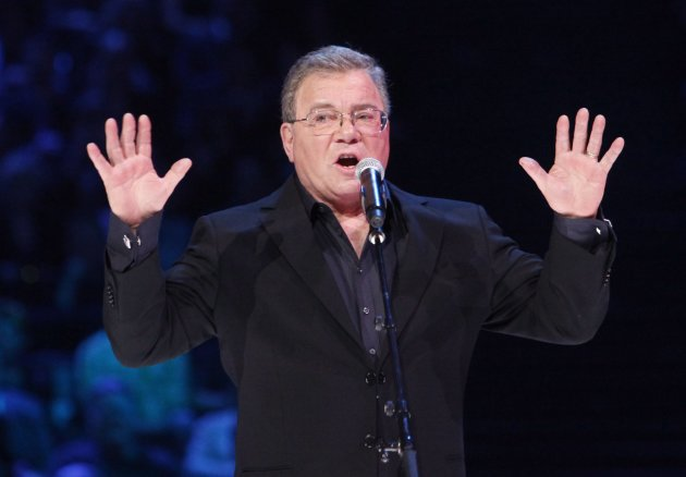 FILE - In this April 1, 2012 file photo, William Shatner hosts the Juno Awards in Ottawa, Ontario. A publicist for the actor tells The Virginian-Pilot the former commander of the fictional starship Enterprise on TV&#39;s &quot;Star Trek&quot; is abandoning plans to attend the Saturday, Dec. 1 retirement ceremony for the USS Enterprise at Norfolk Naval Station. He announced earlier he would be attending. (AP Photo/The Canadian Press, Fred Chartrand, File)