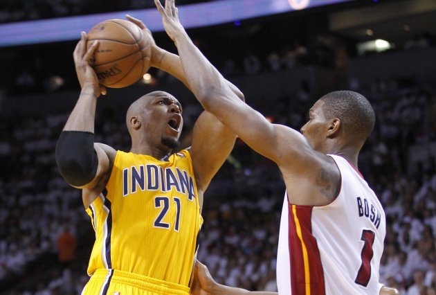 Heat's Bosh fouls Pacers' West during Game 2 of their NBA Eastern Conference final playoff in Miami