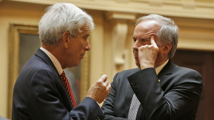 State Sen. John Watkins, R- Powhatan, right, talks with minority leader, Sen. Richard Saslaw, D-Fairfax, left, during the Senate session at the Capitol Thursday, Jan. 31, 2013 in Richmond, Va. (AP Photo/Steve Helber)