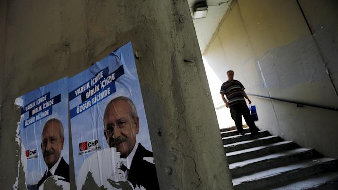 Torn election posters of main opposition Republican People's Party (CHP) with pictures of its leader Kemal Kilicdaroglu are pictured at an underground passage in Istanbul