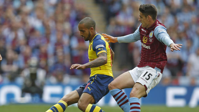 SOC: Arsenal's Theo Walcott in action with Aston Villa's Ashley Westwood