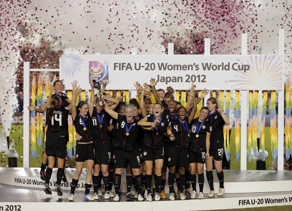 U.S. women's soccer team members celebrate after defeating Germany 1-0 to win the U20 women's World Cup final in Tokyo, Saturday, Sept. 8, 2012. (AP Photo/Itsuo Inouye)