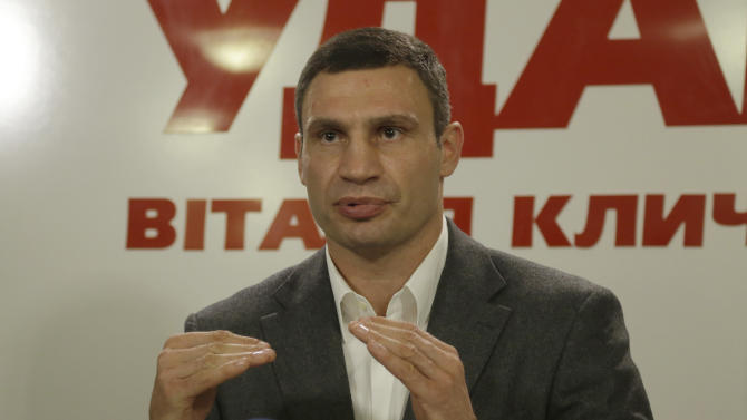 Chairman of the Ukrainian democratic opposition Ukrainian Democratic Alliance for Reform Party and WBC Heavyweight Champion boxer, Vitali Klitschko  speaks to the media  during his press conference in Kiev, Ukraine, Sunday, Oct. 28, 2012. Ukrainians are electing a parliament on Sunday in a crucial vote tainted by the jailing of top opposition leader Yulia Tymoshenko and fears of election fraud. (AP Photo/Efrem Lukatsky)