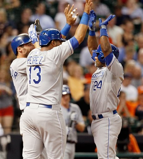 Kansas City Royals shortstop Miguel Tejada (24) receives high fives from Salvador Perez and Jeff Francoeur after hitting a three-run home run in the fourth inning against the Houston Astros during a b