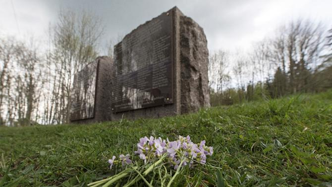 Flowers in front of a memorial stone near the gas chamber of the former Nazi concentration camp in Natzwiller-Struthof, eastern France, on April 26, 2015