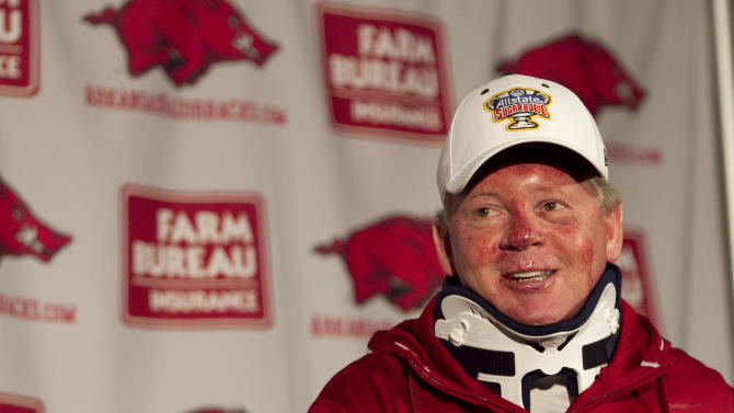 Arkansas football coach Bobby Petrino speaks during a news conference at a Fayetteville, Ark., on Tuesday, April 3, 2012, after being released from a hospital after he was injured in a motorcycle accident on Sunday, April 1. The 51-year-old says he was not wearing a helmet at the time of the crash, which occurred on Arkansas Highway 16 in Madison County _ about 20 miles southeast of Fayetteville. State law does not require an adult rider wear a helmet. (AP Photo/Gareth Patterson)