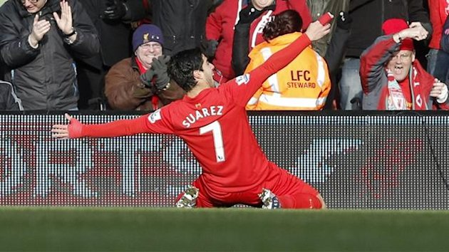 Luis Suarez celebrates his goal against Tottenham (Reuters)