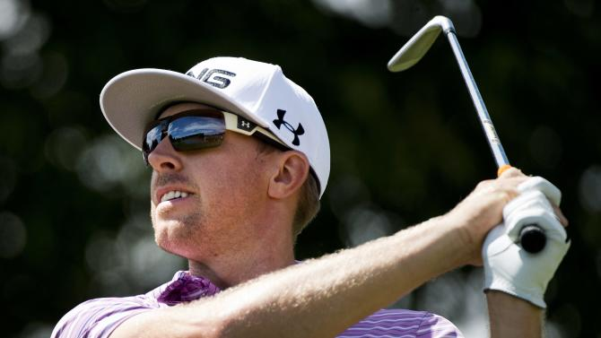 Hunter Mahan watches his tee shot on the seventh hole in the second round of the Canadian Open golf tournament at Glen Abbey in Oakville, Ontario, on Friday, July 26, 2013. (AP Photo/The Canadian Press, Nathan Denette)