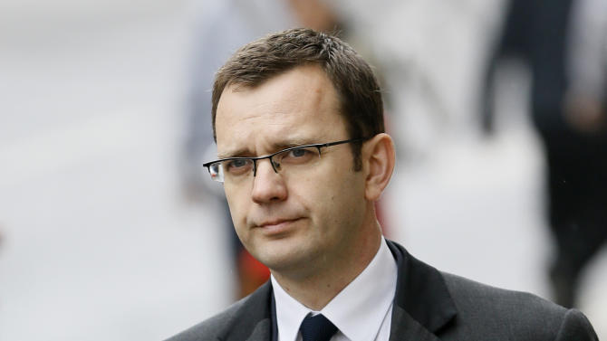 "Andy Coulson, the ex-communications chief for Prime Minister David Cameron, arrives for a bribery hearing at the Old Bailey court in the City of London, Friday, March 8, 2013, in London.  Coulson is appearing to answer charges relating to the alleged requesting and authorising of payments to public officials in exchange for information, including a royal phone directory known as the ""green book"". Coulson denies the charges.(AP Photo/Kirsty Wigglesworth)"