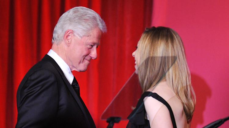 Former President Bill Clinton and amfAR honoree, is introduced by his daughter Chelsea Clinton at amfAR's annual New York Gala at Cipriani Wall Street on Wednesday, Feb. 9, 2011 in New York. amfAR, The Foundation for AIDS Research, is celebrating it's 25th anniversary this year. (AP Photo/Evan Agostini)