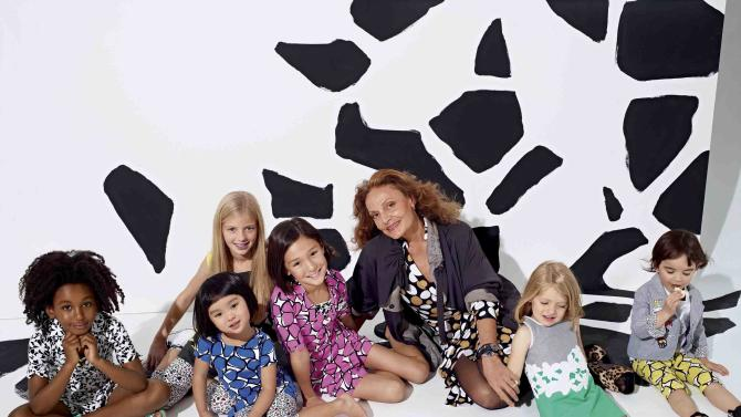 In this product image released by GapKids + DVF, designer Diane Von Furstenberg poses with children wearing her designs.  The items worn by the children part of the GapKids + DVF collection exclusively for girls ranging from newborn to age fourteen.  The line will launch in US stores and US online on March 15, 2012. (AP Photo/GapKids + DVF)