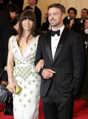 "FILE - In this May 7, 2012, file photo, Jessica Biel and Justin Timberlake arrive at the Metropolitan Museum of Art Costume Institute gala benefit, celebrating Elsa Schiaparelli and Miuccia Prada in New York. Biel says that before Timberlake proposed, she didn't expect to ever get married. The 30-year-old actress told The Associated Press on Friday that she feels ""wonderful"" about the engagement. The couple reportedly became engaged late last year but rarely speak publicly about their relationship. (AP Photo/Evan Agostini, File)"