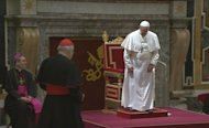 Pope Francis prepares to greet cardinals, moments before stumbling in Sala Clementina, at the Vatican, Friday, March 15, 2013. The newly appointed Pope Francis stumbled after being introduced to the College of Cardinals, but did not fall and quickly recovered. Cardinal Angelo Sodano, second left, introduced the pope to the College of Cardinals. (AP Photo/Vatican TV) TV OUT