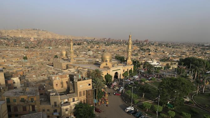 In this Tuesday, June 11, 2013 photo, a general view shows El Sayyeda Nafisa mosque in Cairo, Egypt. Egypt's roughly 15 million Sufi Muslims say their places of worship are under threat by rising radicalism. They say that since the country's 2011 uprising that toppled longtime autocrat Hosni Mubarak, shrines held sacred to them have been attacked by hardliners who deem them heretical and idolatrous. Sayyida Nafisa bint Hasan, Sayyida Ruqayya and Sayyeda Zeinab bint Ali, revered by Sufis, are traditionally considered the patron saints of Cairo. (AP Photo/Hassan Ammar)