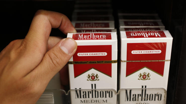 FILE - This Oct. 15, 2010 photo, Marlboro cigarettes are on display at a liquor store in Palo Alto, Calif. Marlboro maker Altria Group Inc. reports quarterly financial results before the market opens on Tuesday, July 22, 2014. (AP Photo/Paul Sakuma, File)
