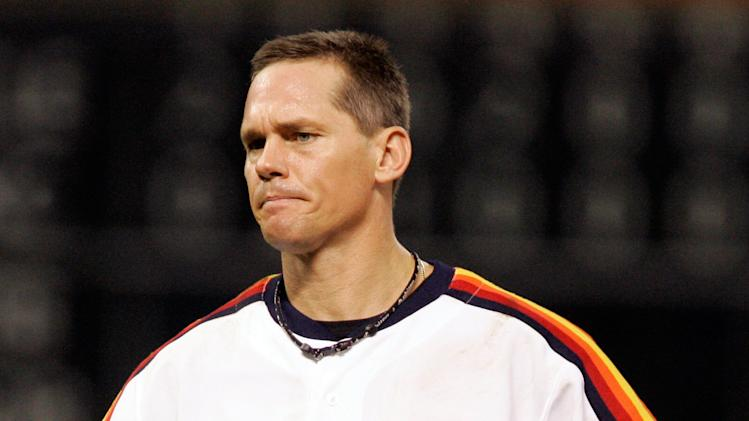 FILE - This Sept. 28, 2007 file photo shows Houston Astros' Craig Biggio grimacing during a baseball game against the Atlanta Braves in Houston. Steroid-tainted stars Barry Bonds, Roger Clemens and Sammy Sosa have been denied entry to baseball's Hall of Fame with voters failing to elect any candidates for only the second time in four decades. Biggio, 20th on the career list with 3,060 hits, topped the 37 candidates with 68.2 percent of the 569 ballots, 39 shy of the 75 percent needed. (AP Photo/Pat Sullivan, File)
