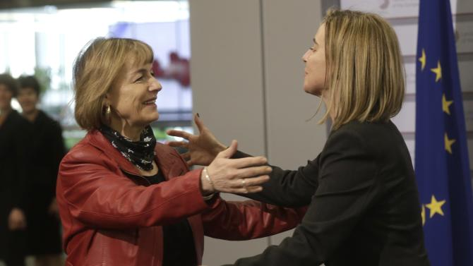 European Union Foreign Policy Chief Mogherini greets Croatia's Minister of Foreign Affairs Pusic during the informal European Union Ministers of Foreign Affairs meeting in Riga