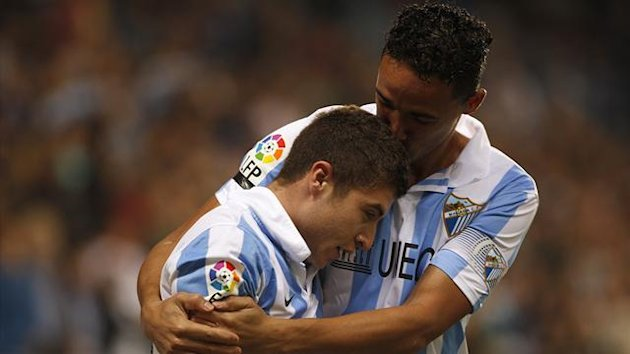 Malaga's Francisco Portillo (L) is kissed by his team mate Wellington Robson (Reuters)