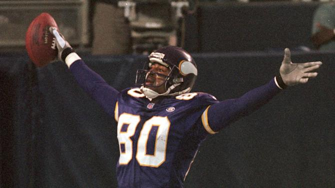 FILE - In this Nov. 8, 1999 file photo, Minnesota Vikings wide receiver Cris Carter (80) celebrates his 6-yard touchdown pass from quarterback Jeff George during the third quarter against the Dallas Cowboys, in Minneapolis. Carter was selected to the Pro Football Hall of Fame on Saturday, Feb. 2, 2013. (AP Photo/Tom Olmscheid, File)