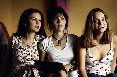 "(Left to right) Polexia ( Anna Paquin ), Sapphire ( Fairuza Balk ) and Estrella ( Bijou Phillips ) are three of the ""band aids"" following the Stillwater tour in Dreamworks' Almost Famous"