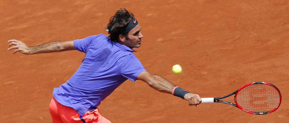 The Latest: Federer into French Open quarters for 11th time