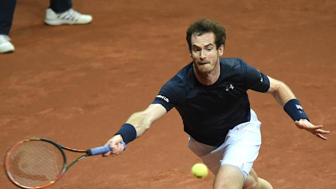 Britain's Andy Murray returns a ball to Belgium's David Goffin during their Davis Cup final tennis match at the Flanders Expo in Ghent, Belgium, Sunday, Nov. 29, 2015. (AP Photo/Geert Vanden Wijngaert)