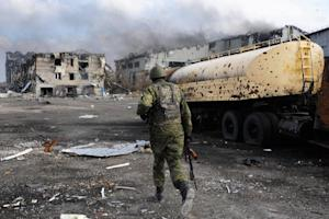 A pro-Russian separatist soldier runs at Donetsk's…