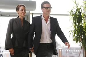 Angelina Jolie and Brad Pitt arrive at a summit to end sexual violence in conflict, in London