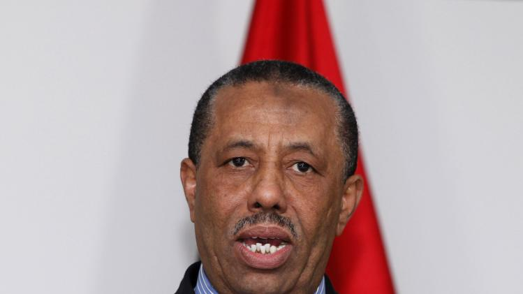 Libya's acting prime minister Thinni speaks during a news conference in Tripoli