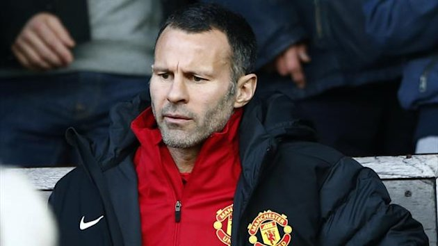 Manchester United's Ryan Giggs sits in the stand before their English Premier League soccer match against Norwich City at Old Trafford in Manchester, northern England, March 2, 2013 (Reuters)