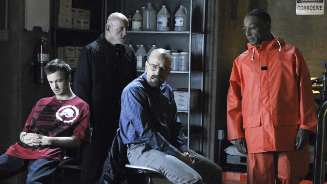 "File-In this publicity image released by AMC, from left, Aaron Paul, Jonathan Banks, Bryan Cranston and Giancarlo Esposito are shown in a scene from the premiere episode of Season 4 of  ""Breaking Bad,"". The AMC hit television series about the methamphetamine wars in Albuquerque is helping the homeless. New Mexico's largest emergency shelter says the show recently donated boxes of clothing worn by cast members in past episodes. (AP Photo/AMC, Ursula Coyote,File)"