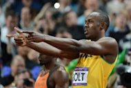 El jamaiquino Usain Bolt gesticula antes de los 100m planos en Londres-2012, el 5 de agosto de 2012. (AFP | franck fife)