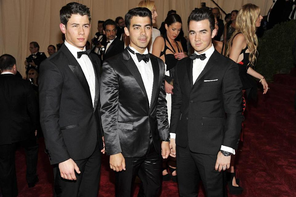 Nick Jonas, left, Joe Jonas, center and Kevin Jonas arrive at the Metropolitan Museum of Art Costume Institute gala benefit, celebrating Elsa Schiaparelli and Miuccia Prada, Monday, May 7, 2012 in New York. (AP Photo/Charles Sykes)