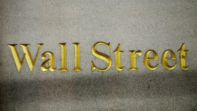 FILE - In this Oct. 8, 2014 file photo, a Wall Street address is carved in the side of a building in New York. U.S. stocks are drifting in early trading Thursday, Oct. 30, 2014, as a parade of big companies turn in quarterly results. A strong gain for Visa pulled the Dow Jones industrial average higher. (AP Photo/Mark Lennihan, File)