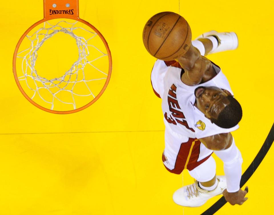 Miami Heat shooting guard Dwyane Wade (3) shoots against the Oklahoma City Thunder at Game 5 of the NBA finals basketball series, Thursday, June 21, 2012, in Miami. The Heat won 121-106 to become the 2012 NBA Champions.(AP Photo/Larry W. Smith, Pool)