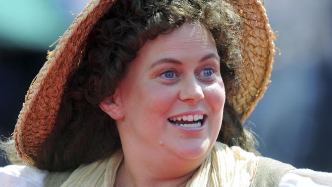 "An actor dressed as Shire folk warms up the crowd on the red carpet for the premiere of  ""The Hobbit: An Unexpected Journey"" in Wellington, New Zealand, Wednesday, Nov. 28, 2012. (AP Photo/SNPA, Ross Setford) NEW ZEALAND OUT"