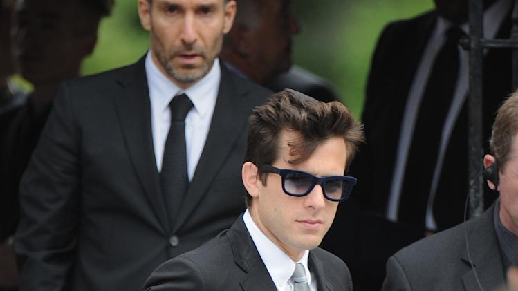 "British musician Mark Ronson, centre, leaves Golders Green,Crematorium after attending the funeral of Amy Winehouse in north London, Tuesday, July 26, 2011 .  The soul diva, who had battled alcohol and drug addiction, was found dead Saturday at her London home. She was 27.  Ronson produced her multi-award winning album ""Back to Black"". (AP Photo/Joel Ryan)"