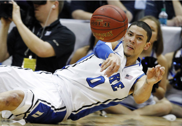 Duke guard Austin Rivers (0) passes the ball against Florida State during the second half of an NCAA college basketball game in the semifinals of the Atlantic Coast Conference tournament, Saturday, Ma