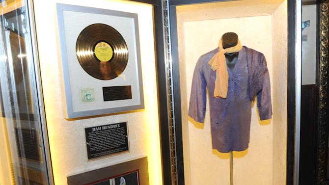 "A purple silk shirt Jimi Hendrix wore on stage is displayed at the launch of Hard Rock International's traveling music memorabilia collection, ""Music Gives Back,"" Wednesday, Feb. 13, 2013, at Hard Rock Cafe New York.   ""Music Gives Back"" focuses on artists who have worked with Hard Rock on charitable campaigns  and will be on tour at Hard Rock locations in the U.S. throughout 2013. (Photo by Diane Bondareff/Invision for Hard Rock International/AP Images)"