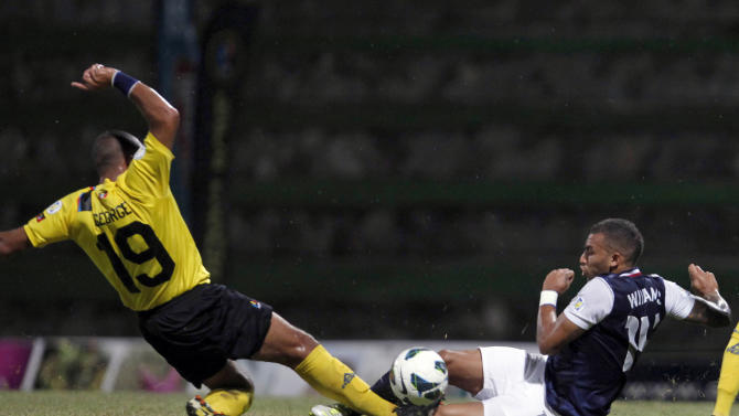US' Danny Williams, right, fights for the ball with Antigua and Barbuda's Luke Anthony George during a 2014 World Cup qualifying soccer match in St. John, Antigua and Barbuda, Friday, Oct. 12, 2012. (AP Photo/Ricardo Arduengo)