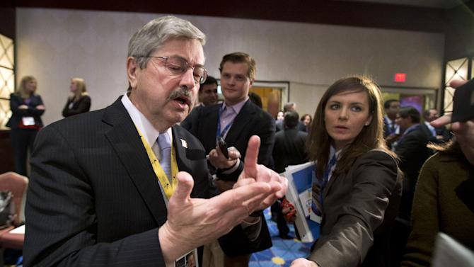 Iowa Gov. Terry Branstad, left, speaks to reporters during a break at the opening session of the National Governors Association 2013 Winter Meeting in Washington, Saturday, Feb. 23, 2013. Exasperated governors who are trying to gauge the fallout from impending federal spending cuts say Washington's protracted budget stalemate could seriously undermine the economy and stall gains made since the recession.  (AP Photo/Manuel Balce Ceneta)