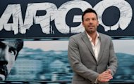 "US actor and film director Ben Affleck poses during the photocall for ""Argo"" on October 19 at a hotel in Rome. Horror flick ""Paranormal Activity 4"" opened atop the North American box office this weekend, while political thriller ""Argo"" held onto second place, industry estimates showed Sunday"
