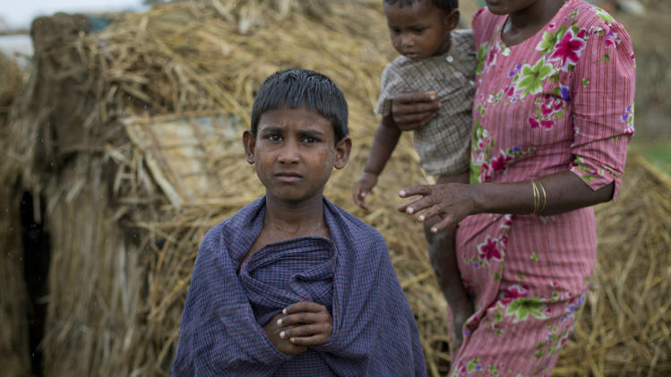 An internally displaced Rohingya boy stands at a camp for displaced Rohingya people in Sittwe, northwestern Rakhine State, Myanmar, ahead of the arrival of Cyclone Mahasen, Wednesday, May 15, 2013. A massive evacuation to clear low-lying camps ahead of the cyclone has run into a potentially deadly snag as members of the displaced Rohingya minority living there have refused to leave because they don't trust Myanmar authorities. (AP Photo/Gemunu Amarasinghe)