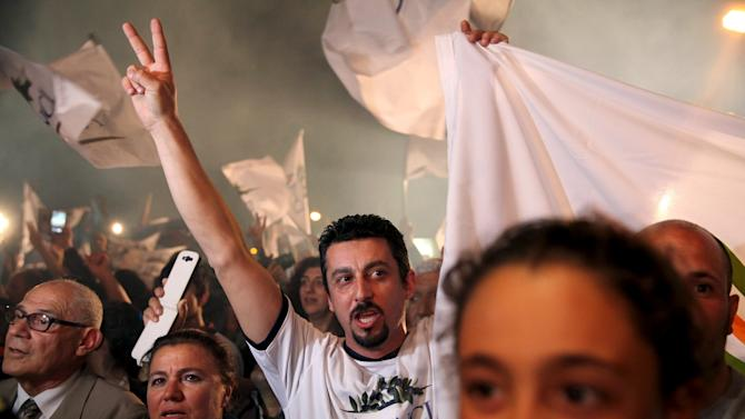 Supporters of Turkish Cypriot politician Mustafa Akinci celebrate after the election victory in Nicosia