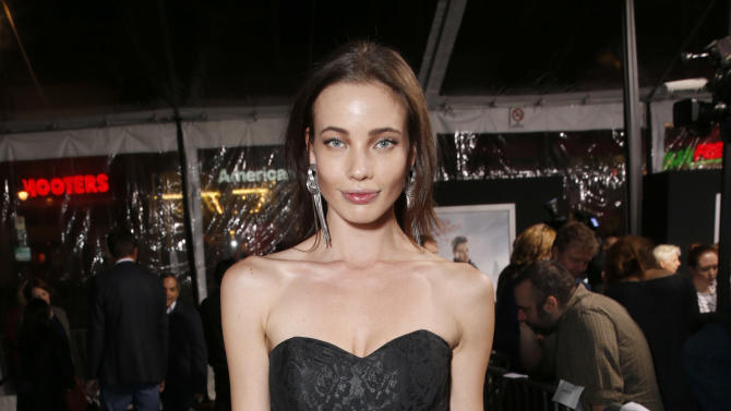 """Stephanie Corneliussen arrives at the premiere of """"Hansel & Gretel Witch Hunters"""" on Thursday Jan. 24, 2013, in Los Angeles.  (Photo by Todd Williamson/Invision/AP)"""