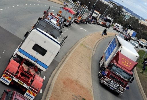 The anti-carbon tax protest known as The Convoy of No Confidence encircles the Parliament House ring road in Canberra in August 2011. Australia's lower house of parliament passed a contentious new tax on carbon pollution to combat climate change on Wednesday with the support of key crossbench MPs