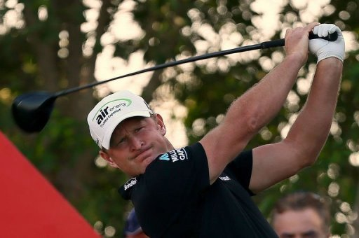 Jamie Donaldson of Wales plays a shot during the final round of the Abu Dhabi Golf Championship at the Abu Dhabi Golf Club on January 20, 2013. Donaldson reeled in red-hot Justin Rose to win the championship