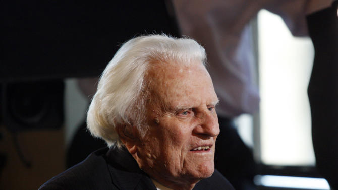 FILE - In this Dec. 20, 2010 file photo, evangelist Billy Graham speaks to the media at the Billy Graham Evangelistic Association headquarters in Charlotte, N.C. A spokesman for Graham says the 93-year-old evangelist has been admitted to a North Carolina hospital for an infection in his lungs. A joint statement Sunday, Aug. 12, 2012, from Graham's spokesman and Mission Hospital says Graham was admitted overnight for evaluation and treatment of an infection thought to be bronchitis. The hospital is in Asheville, near his home in Montreat. (AP Photo/Nell Redmond, File)