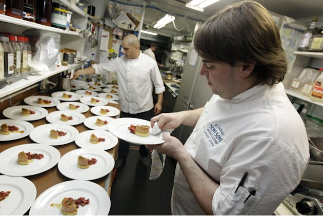Chef and owner Josiah Slone, right, prepares a foie gras dish at Sent Sovi Friday, May 11, 2012 in Saratoga, Calif. This is not a good time to be a duck in California. As a July 1 deadline looms for f